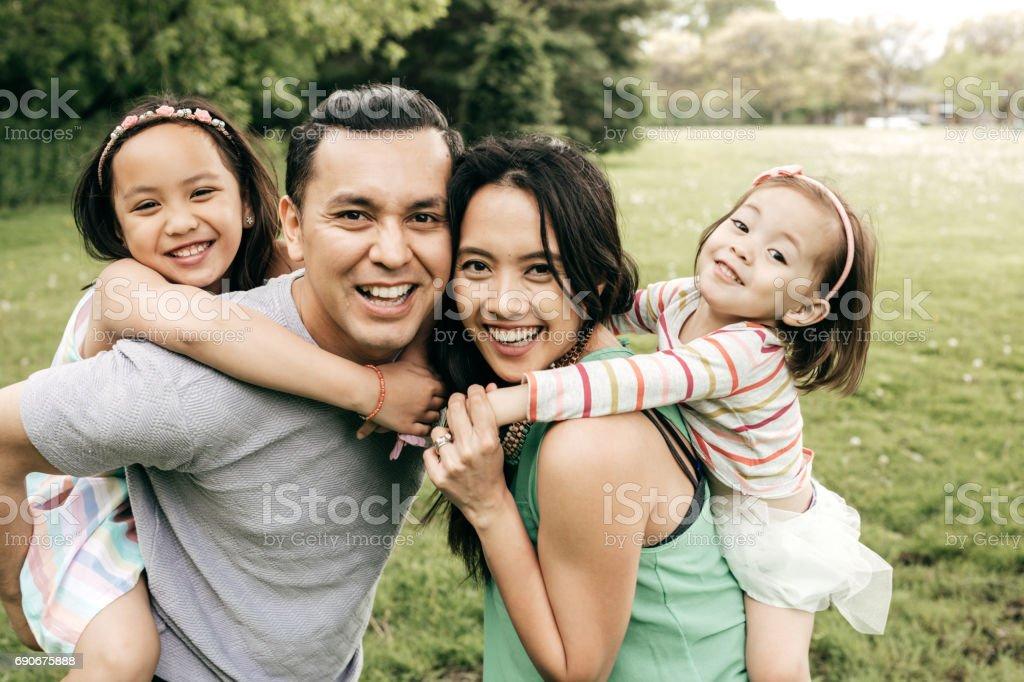 Happy family having fun outdoor royalty-free stock photo