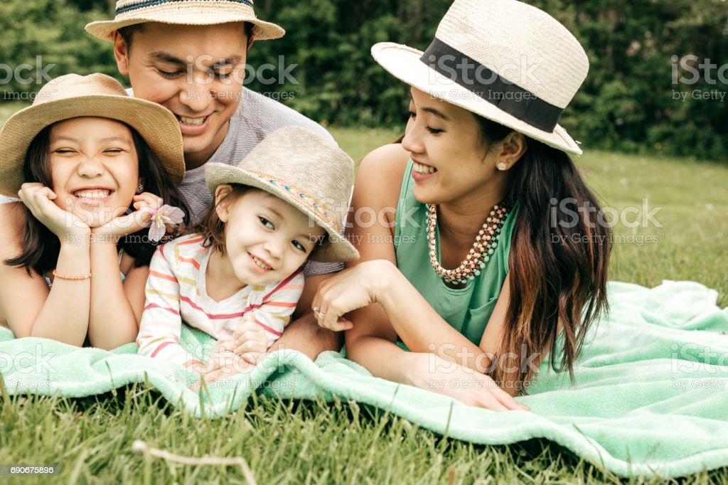 Happy family having fun outdoor stock photo
