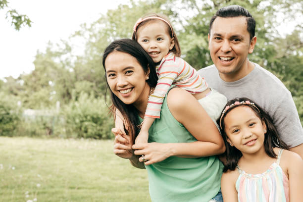 Happy family having fun outdoor Happy family outdoor southeast asian ethnicity stock pictures, royalty-free photos & images