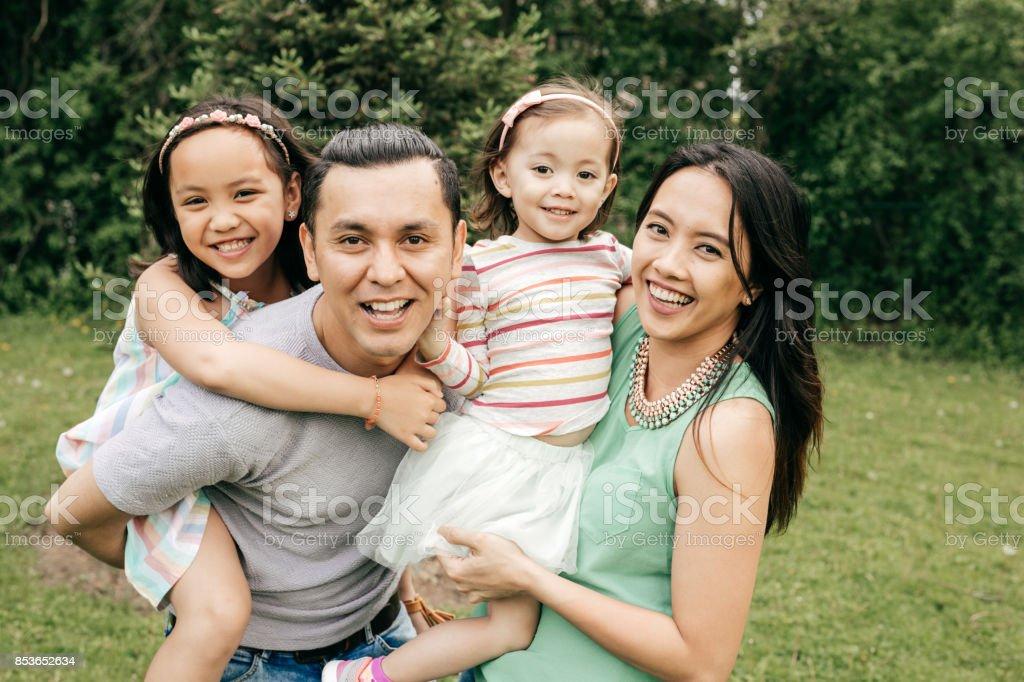 Happy family having fun outdoor stock photo