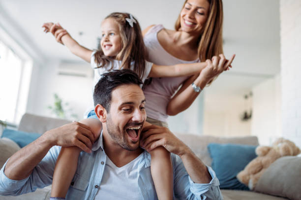 happy family having fun time at home - family stock pictures, royalty-free photos & images