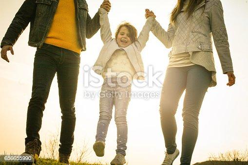 658444674istockphoto Happy family heaving fun in the park. 656655990