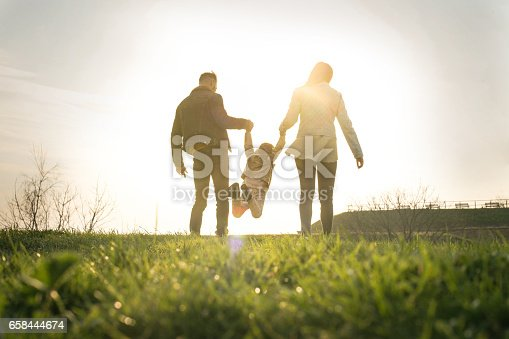 istock Happy family heaving fun in the park. 658444674