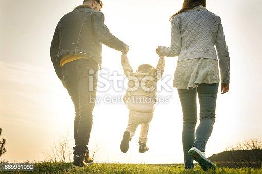 658444674istockphoto Happy family heaving fun in the park. 665991092