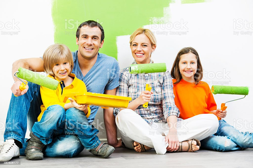 Happy family holding Work Tools. stock photo