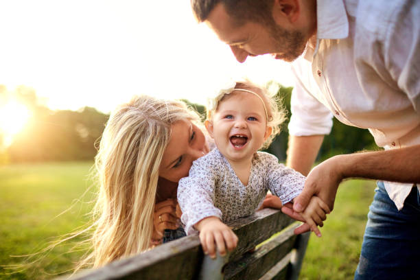 Happy family in a park in summer autumn stock photo
