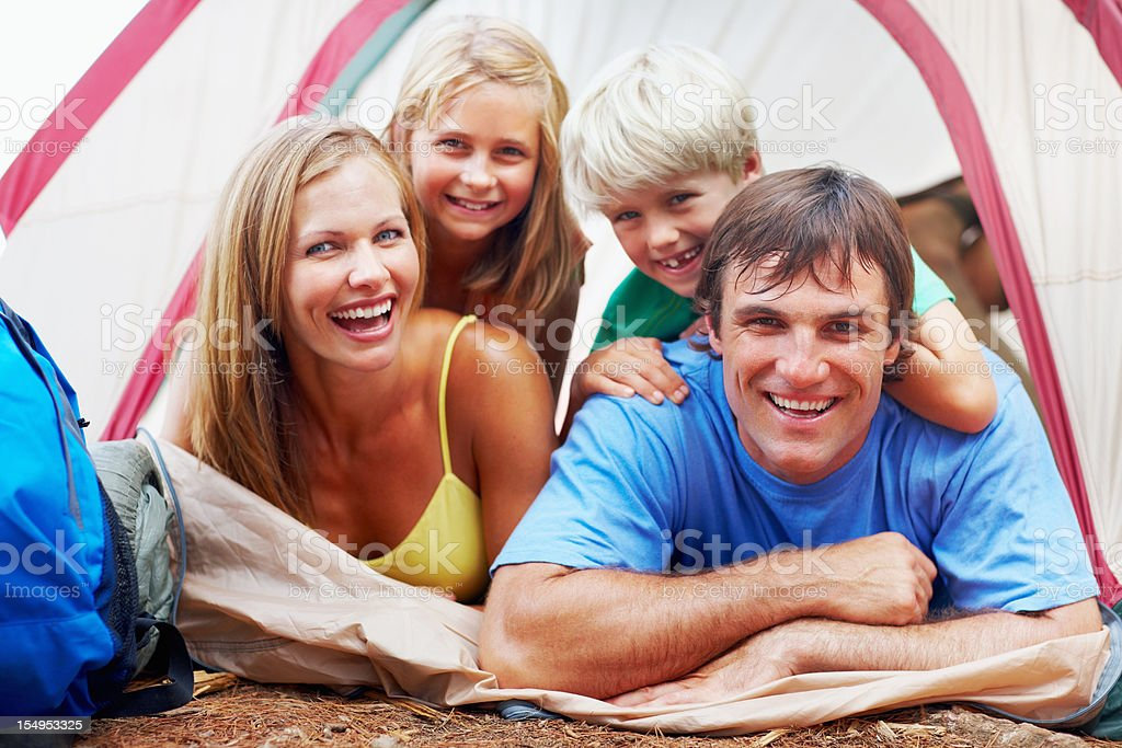 Happy family in a tent royalty-free stock photo
