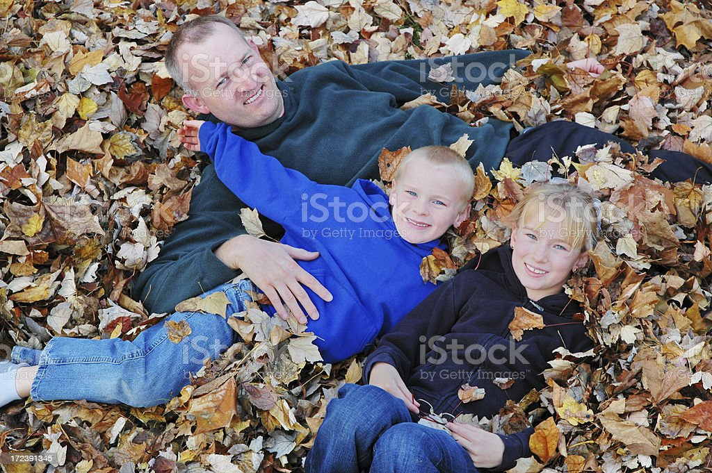 Happy Family in Autumn Leaves royalty-free stock photo
