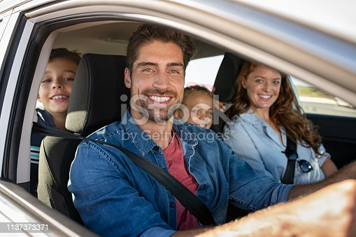istock Happy family in car 1137373371