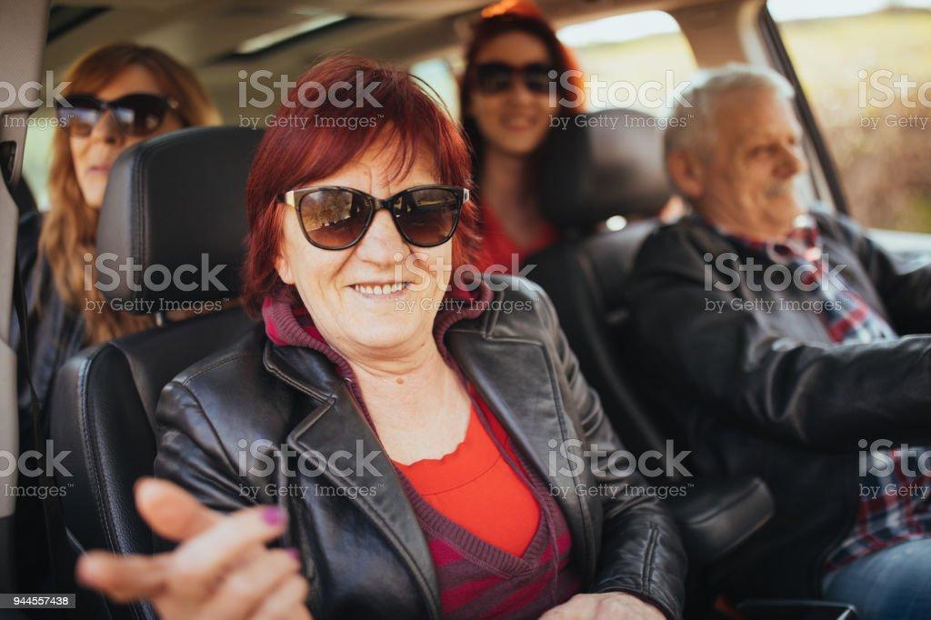 Happy family in car
