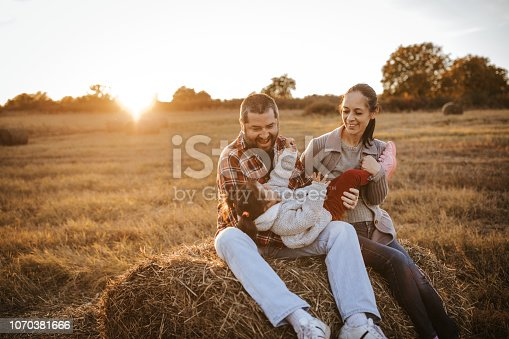 523172398istockphoto Happy family in countryside 1070381666
