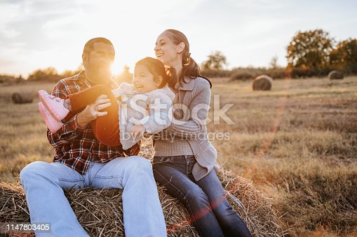 523172398istockphoto Happy family in countryside 1147803405
