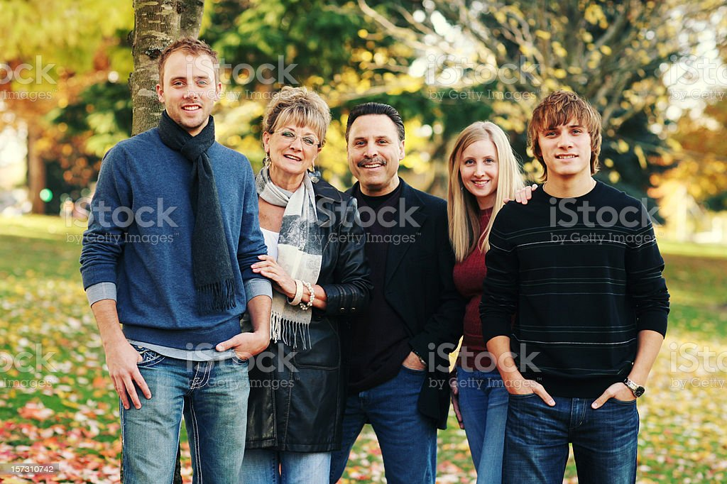 Happy Family in Jeans Together at a Park royalty-free stock photo