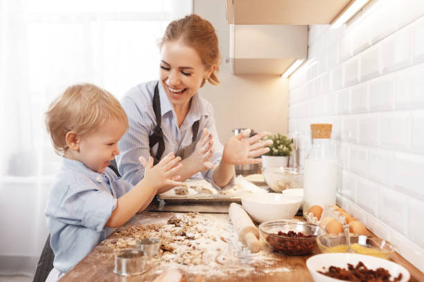 Happy family in kitchen mother and child baking cookies picture id951736594?b=1&k=6&m=951736594&s=612x612&w=0&h=dnrxjfeoioif7je46vudau7s8mpskj3nk9otstap274=