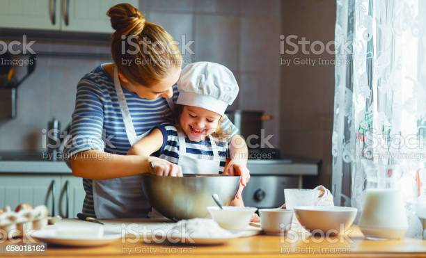 Happy family in kitchen mother and child preparing dough bake cookies picture id658018162?b=1&k=6&m=658018162&s=612x612&h=bond s 1jr5tgpssx j3hyjigyfhjwu twfvuhuk0pk=