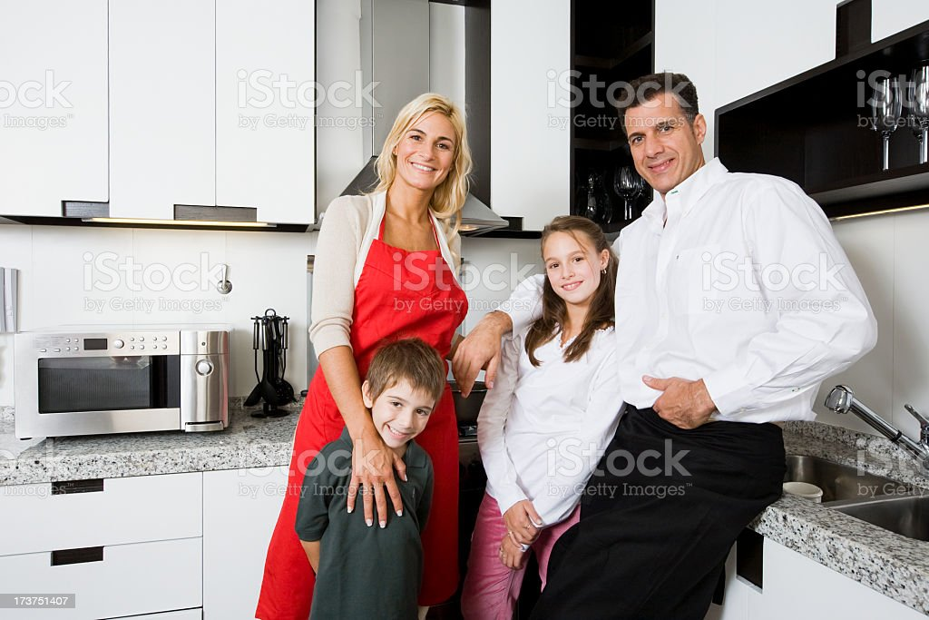 Happy family in kitchen royalty-free stock photo