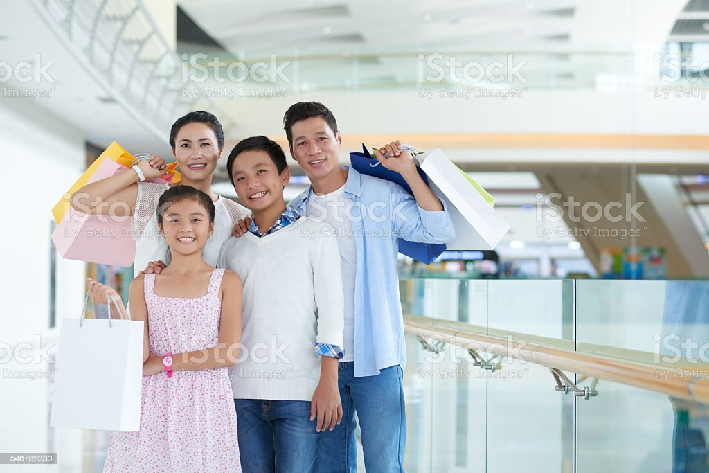 Happy family in mall stock photo
