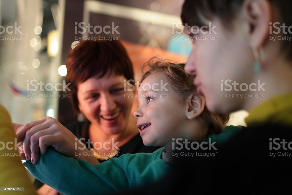 Happy family in museum royalty-free stock photo