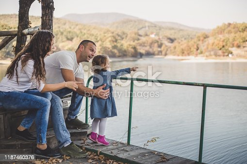 588959064istockphoto Happy family in nature park 1187460376