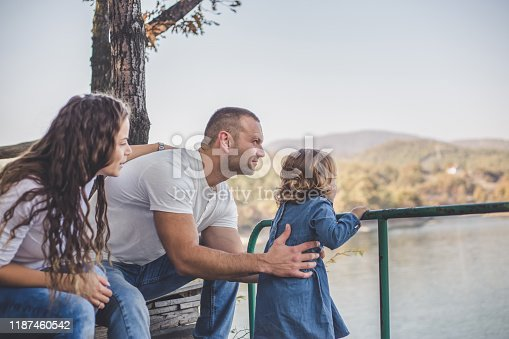 588959064istockphoto Happy family in nature park 1187460542