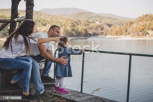 588959064istockphoto Happy family in nature park 1187460566