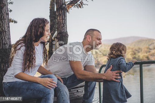 588959064istockphoto Happy family in nature park 1187460577