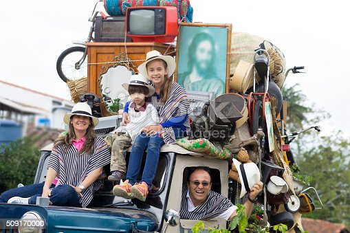 Portrait of Happy Family, Father, Mother And Their Children in Old Car Outdoors