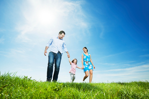 Happy family in park taking a walk