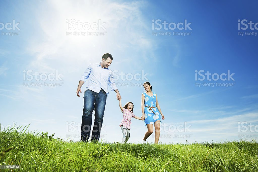 Happy family in park taking a walk stock photo