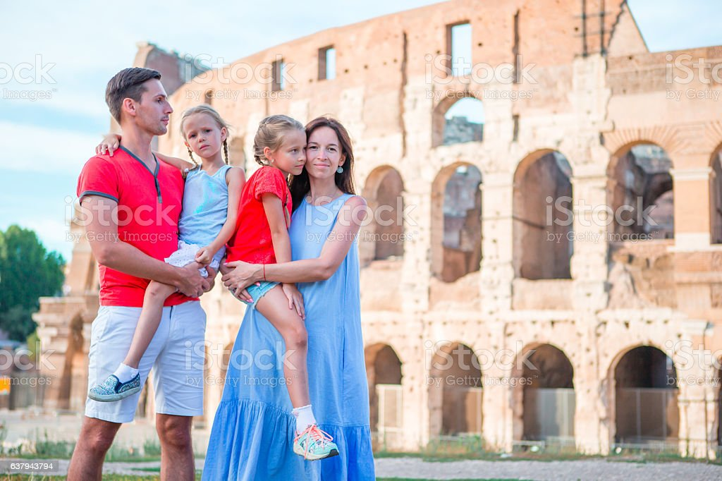 Happy family in Rome over Colosseo background. Italian european vacation  royalty-free stock photo