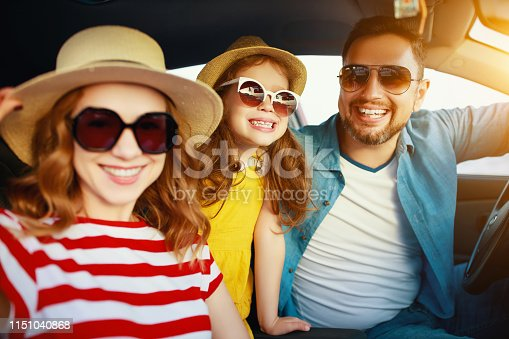 147878016 istock photo happy   family  in summer auto journey travel by car on beach 1151040868