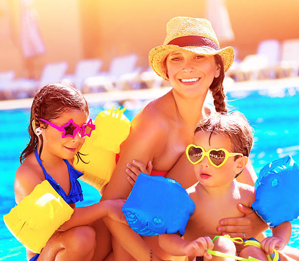 happy family in summer vacation - children play water park stock photos and pictures