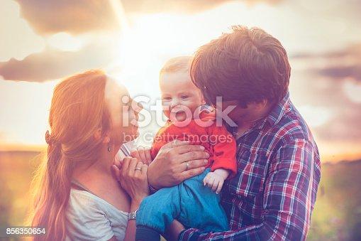 istock Happy family in sunset 856350654