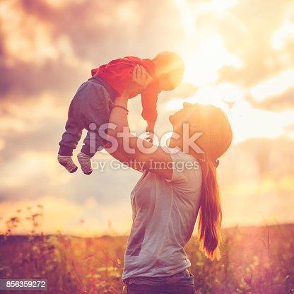 525959168 istock photo Happy family in sunset 856359272