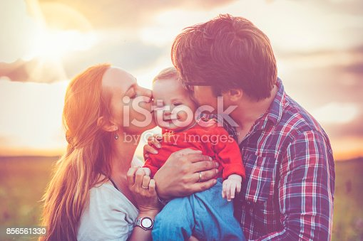 istock Happy family in sunset 856561330