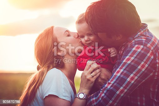 istock Happy family in sunset 925870786