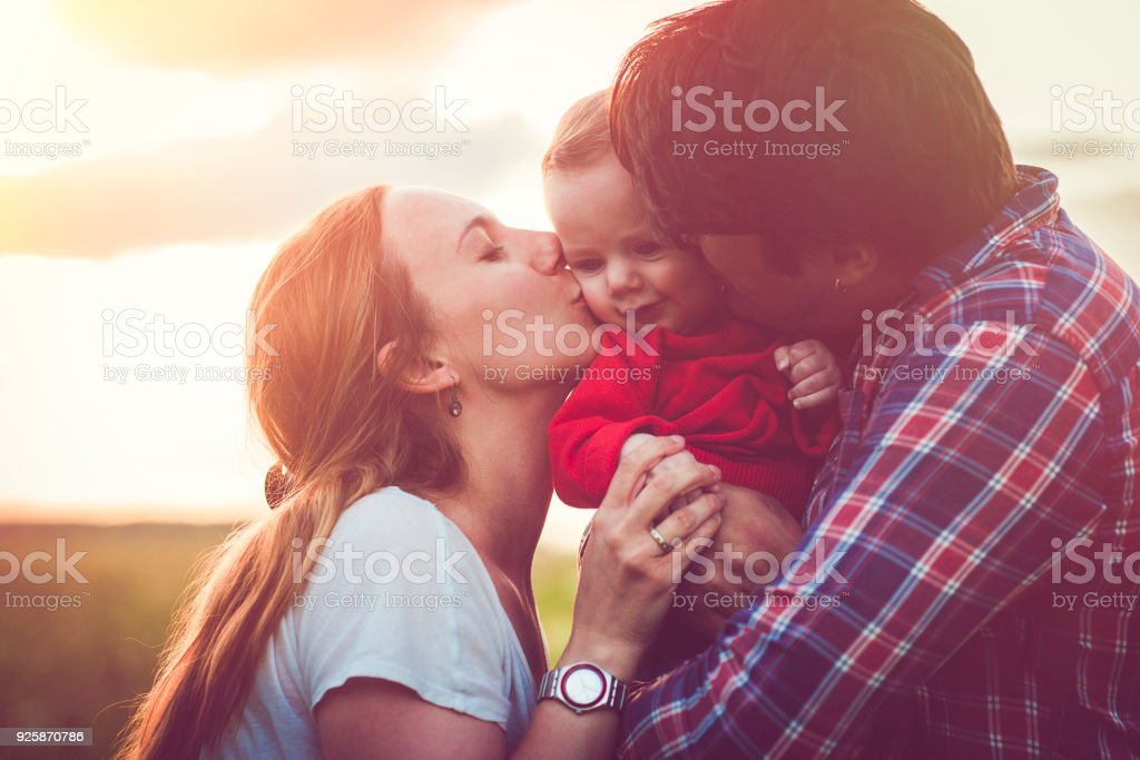 Happy family in sunset stock photo