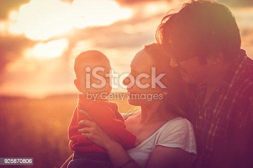 istock Happy family in sunset 925870806