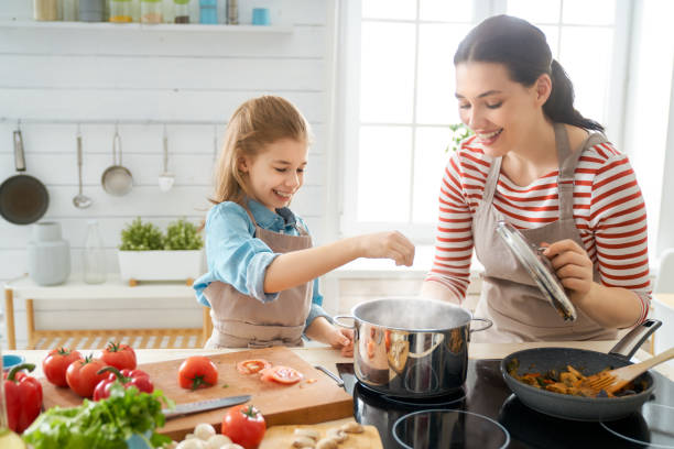 Happy family in the kitchen. stock photo