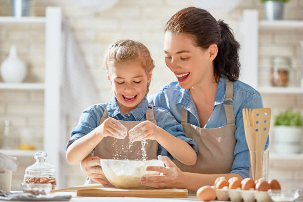 happy family in the kitchen. - kids cooking stock photos and pictures