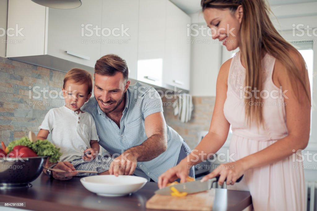 Happy family in the kitchen royalty-free stock photo
