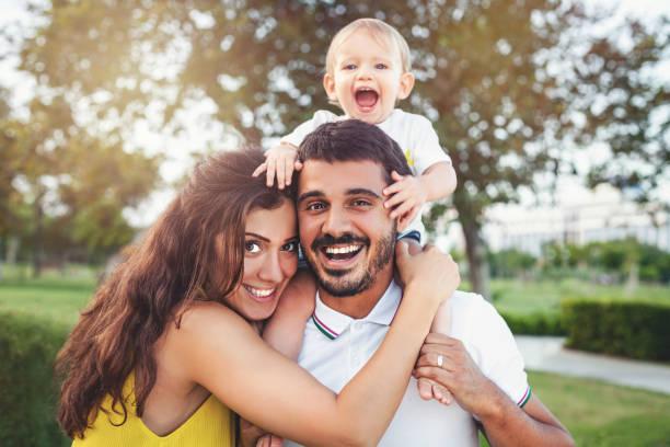 Happy family in the park stock photo
