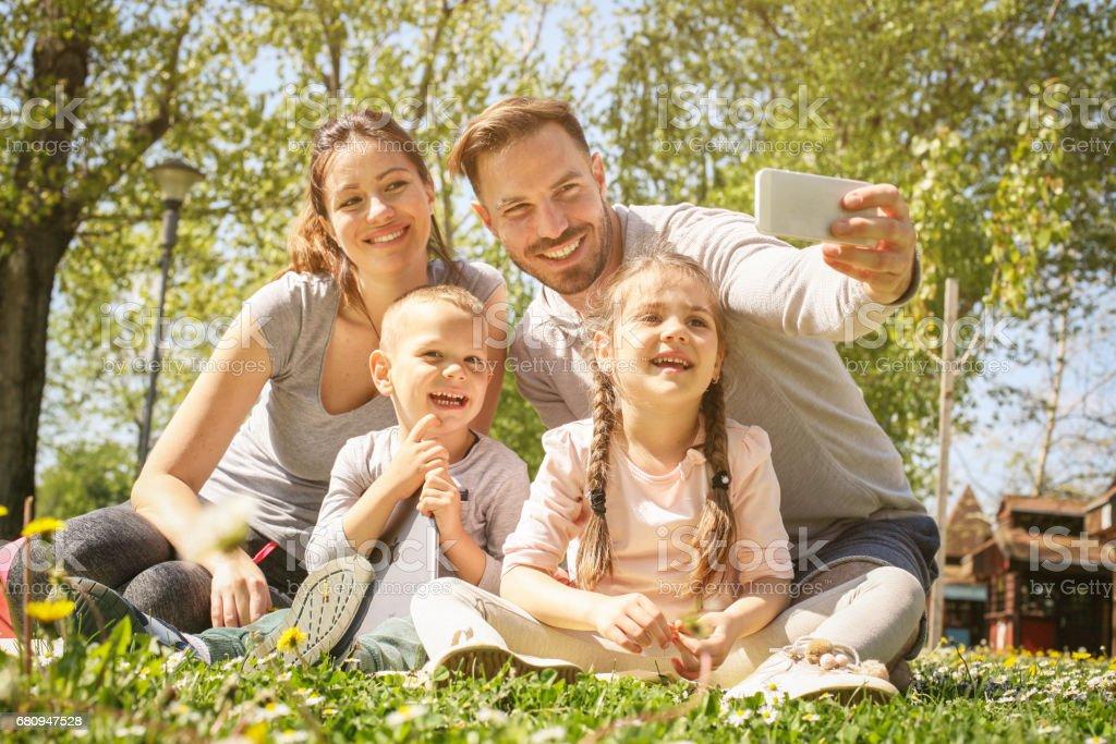 Happy family in the park. royalty-free stock photo