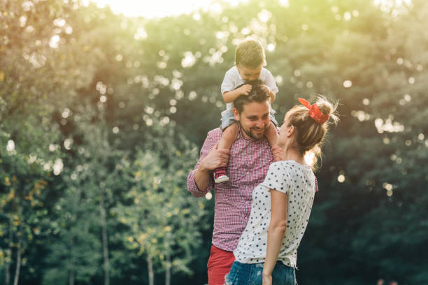 happy family in the park - public park stock photos and pictures