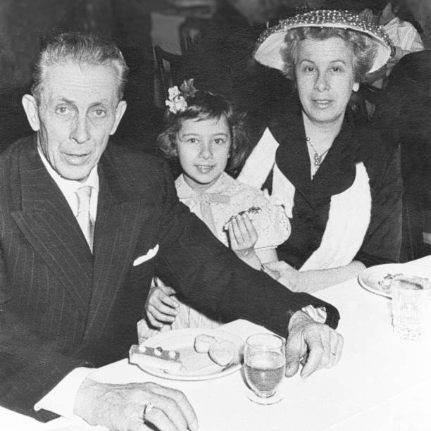 Happy family in the restaurant in 1958