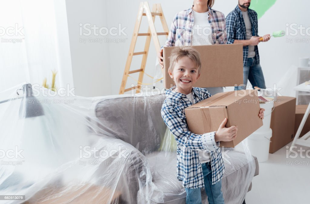 Happy family in their new home royalty free stockfoto