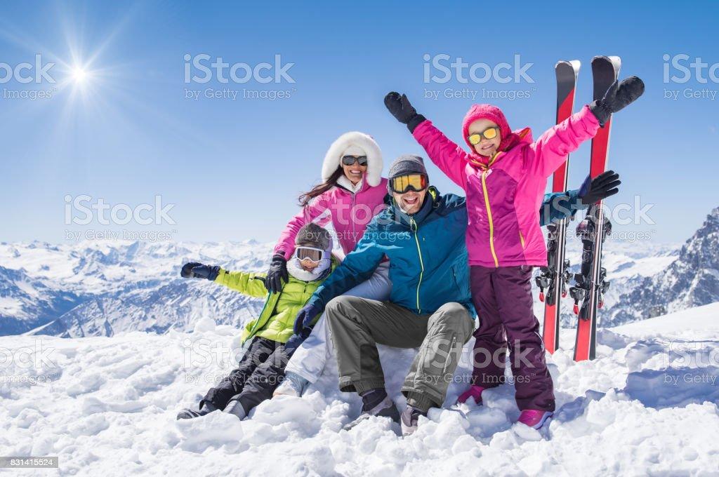 Happy family in winter holiday stock photo