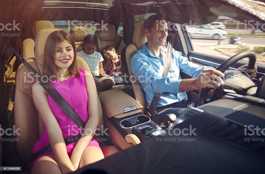 Happy family inside car stock photo