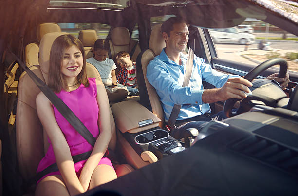 Happy family inside car stock photo