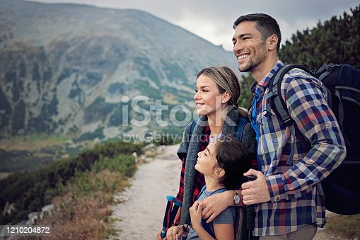 Happy family is hiking in the mountain